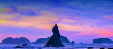 Pacific Sunset with rocks Stock Images