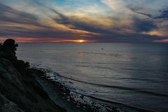 Sunset Over the Pacific Ocean Viewed from the Palos Verdes Peninsula, Los Angeles, California. Dramatic sunset viewed from the Bluff Trail on the cliffs of the royalty free stock photo