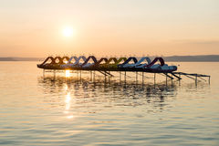 Sunset over paddle boats Royalty Free Stock Image