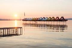Sunset over paddle boats Stock Photo
