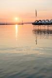 Sunset over paddle boats Stock Image