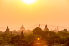 Sunset over pagoda temples with fog of Bagan in Myanmar. Stock Photo