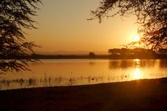 Sunset over the pan. Sun setting at the pan at Mkuze game reserve Royalty Free Stock Photo