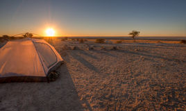 Sunset over the pans. A tent pitched overlooking the makgadikgadi pans stock image