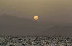 Sunset over Paros island mountains Stock Images