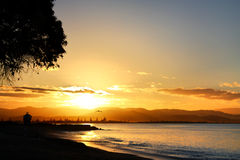Sunset over Perfume Point, Westshore, Hawkes Bay, New Zealand. Golden sunset over Perfume Point, Westshore, Hawke's Bay, New Zealand. Tree and the Point Royalty Free Stock Images