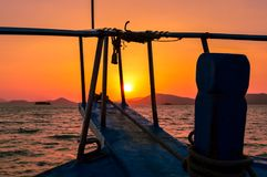 A stunning sunset over Phuket provides the backdrop to a traditional longtail boat, Phuket, Thailand. Sunset over Phuket provides the backdrop to a traditional Stock Photos