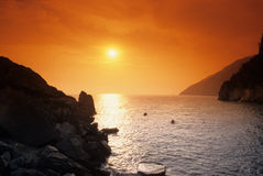 Sunset over picturesque coast Royalty Free Stock Image