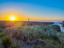 Sunset over pier Royalty Free Stock Images