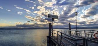 Sunset over pier at lake Garda in Bardolino Italy Royalty Free Stock Photo