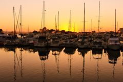 Sunset over the pier in San Diego. Sun setting on the pier and buildings in San Diego royalty free stock image