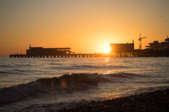 Sunset over the pier and sea Stock Photography