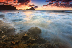 Sunset over Pigeon Island, Northern Saint Lucia. Waves rushing in along the northern coastline of Saint Lucia Stock Image