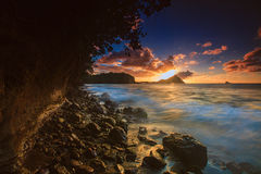 Sunset over Pigeon Island, Northern Saint Lucia. Waves rushing in along the northern coastline of Saint Lucia Royalty Free Stock Image