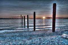 Sunset over the pilings at Point Roberts Stock Images