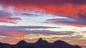 Vibrant Sunset over Pinnacle Peak in North Scottsdale. Fiery and vibrant sunset over Pinnacle Peak in North Scottsdale, Arizona stock photo