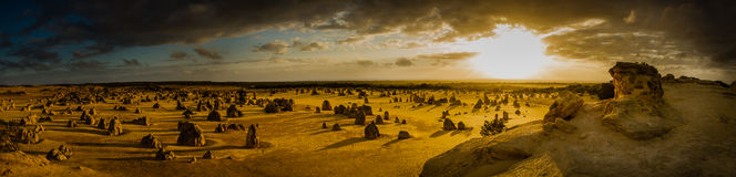 Sunset over Pinnacles desert, Western Australia. Panoramic landscape of pinnacles desert during sunset in Western Australia Royalty Free Stock Image