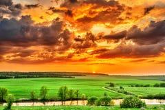 Sunset over the plain Stock Photos