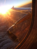 Sunset over a plane wing. Colourful sunset seen through an aeroplane window Royalty Free Stock Photos