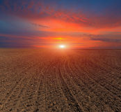 Sunset over plugged field Royalty Free Stock Photography