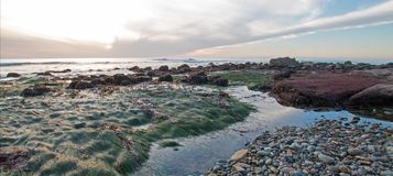 SUNSET OVER POINT LOMA TIDEPOOLS AT CABRILLO NATIONAL MONUMENT IN SAN DIEGO IN SOUTHERN CALIFORNIA USA. SUNSET OVER POINT LOMA TIDEPOOLS AT CABRILLO NATIONAL royalty free stock image