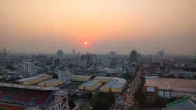 Sunset over polluted city Stock Images