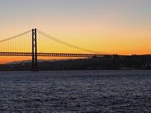 Sunset over 25th april bridge in Lisbon. Sunset over Ponte 25 de Abril bridge in Lisbon in Portugal stock images