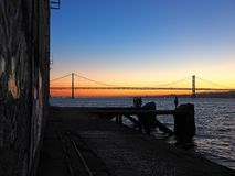 Sunset over 25th april bridge in Lisbon. Sunset over Ponte 25 de Abril bridge in Lisbon in Portugal stock photography