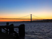Sunset over 25th april bridge in Lisbon. Sunset over Ponte 25 de Abril bridge in Lisbon in Portugal royalty free stock image