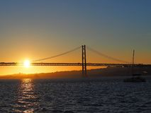Sunset over 25th april bridge in Lisbon. Sunset over Ponte 25 de Abril bridge in Lisbon in Portugal royalty free stock photo