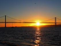 Sunset over 25th april bridge in Lisbon. Sunset over Ponte 25 de Abril bridge in Lisbon in Portugal stock photos