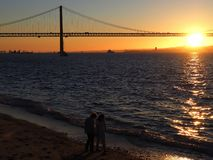 Sunset over 25th april bridge in Lisbon. Sunset over Ponte 25 de Abril bridge in Lisbon in Portugal royalty free stock images