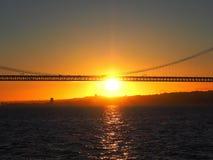 Sunset over 25th april bridge in Lisbon. Sunset over Ponte 25 de Abril bridge in Lisbon in Portugal stock image