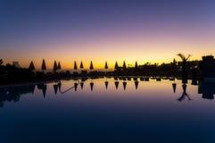 Sunset over pool Stock Photos