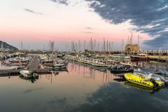 Sunset over the port of imperia stock photography