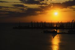 Sunset over the port at sea from a height royalty free stock photos