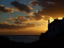 Sunset Over Porthleven in Cornwall. A November sunset on the south west coast of Cornwall in the harbour of Porthleven Stock Photos