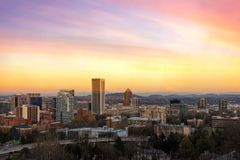 Sunset over Portland OR Cityscape and Mt Hood USA. Portland Oregon downtown cityscape with Mt Hood view during sunset USA America Stock Photos