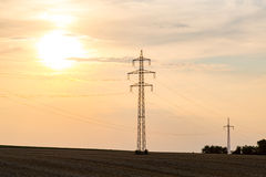 Sunset over the powerlines Royalty Free Stock Photo