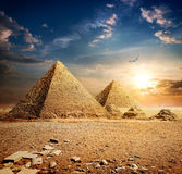 Sunset over pyramids royalty free stock images