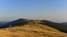 Sunset over the Rânca resort from Transalpina road. Royalty Free Stock Images