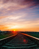 Sunset over railroad in sky with clouds Stock Photography