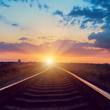 Sunset over railroad Stock Images