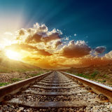 Sunset over railroad to horizon Stock Image