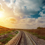 Sunset over railroad to horizon Royalty Free Stock Images