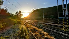 Sunset over the railroads stock photography