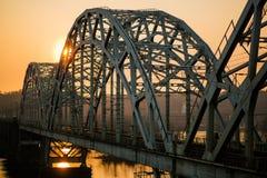 Sunset over railway bridge across Dnepr river. Kiev, Ukraine royalty free stock photography