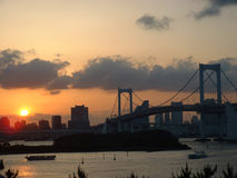 Sunset over Rainbow Bridge. Sunset over Tokyo Bay and Rainbow Bridge, view from Odaiba Royalty Free Stock Image