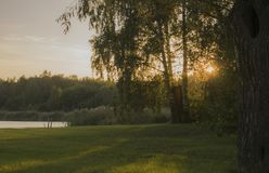 Sunset over the ranch yard with river behind Royalty Free Stock Image