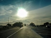 Sunset over receding highway Royalty Free Stock Photos